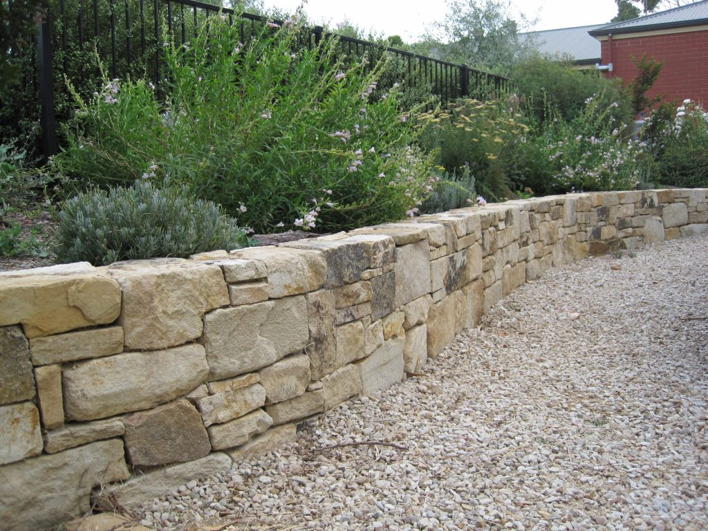 Basket range sandstone other stone features for Rock wall garden designs